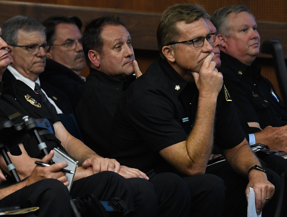 Santa Barbara County Fire Chief Eric Peterson (foreground), with Sheriff Bill Brown second from the left