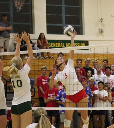 San Marcos' Bella Johnson unleashes a spike in a match against crosstown rival Santa Barbara.
