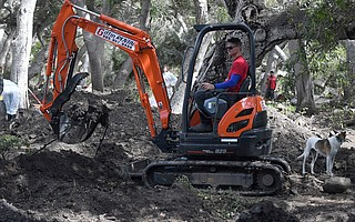 Bucket Brigade founder Abe Powell, seen here operating a mini-excavator, writes that funds are needed to complete the cleanup and the search for two missing children in Montecito.
