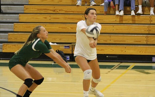 Sky Mainz makes a pass in the third set in front of teammate Hayden Randolph.