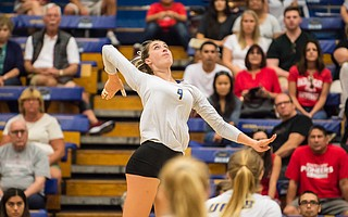 Lindsey Ruddins (4) struck the volleyball over three Sacred Heart blockers last Saturday. She had 26 kills in UCSB's four-set victory.