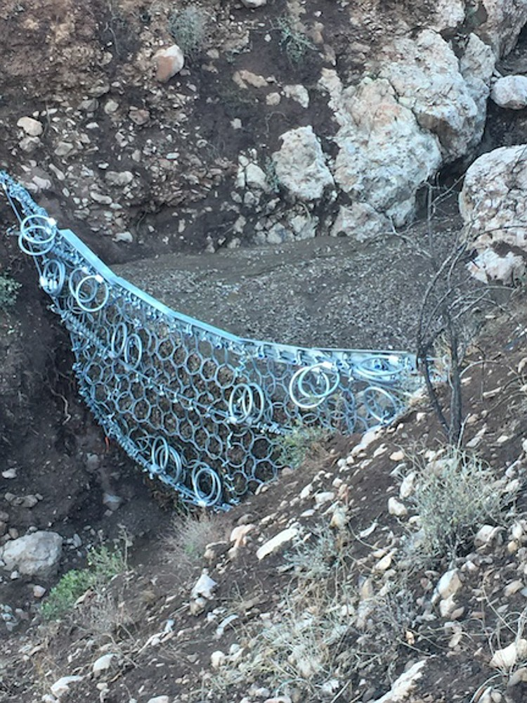 A ring net holds back mud and debris in Camarillo Springs.