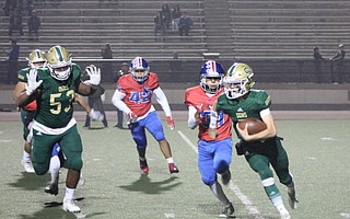 Frankie Gamberdella scrambles in rivalry game against San Marcos Friday night at La Playa Stadium.