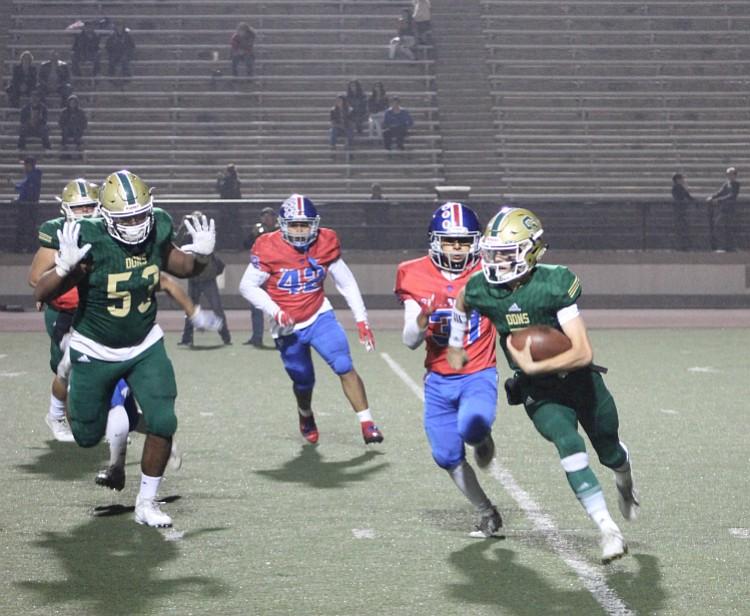 Frankie Gamberdella scrambles in rivalry game against San Marcos Friday night at La Playa Stadium.