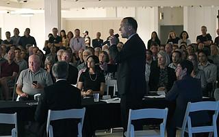 San Luis Obispo City Manager Derek Johnson speaks to a packed house.