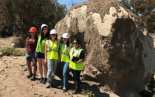 Among the researchers in UCSB's studies of the Montecito disaster are Erica Akemi Goto (left), Michelle Shteyn, Sarah E. Anderson, Violeta Contreras, and Summer Gray, pictured here at a boulder that washed down-canyon during the January 2018 mudflow.