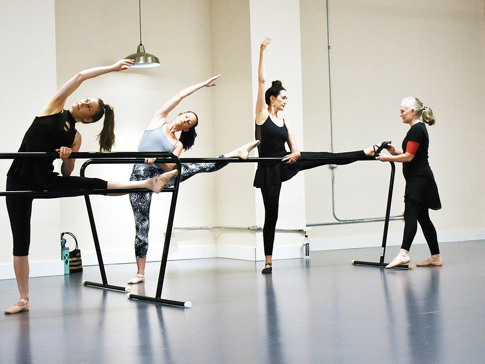 Director of American Dance & Music Carrie Diamond (pictured far right) helps students perfect their ballet skills at her recently opened Dance Hub.