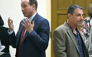 Attorney Eric Early (left) with Jarrod Schwartz of Just Communities