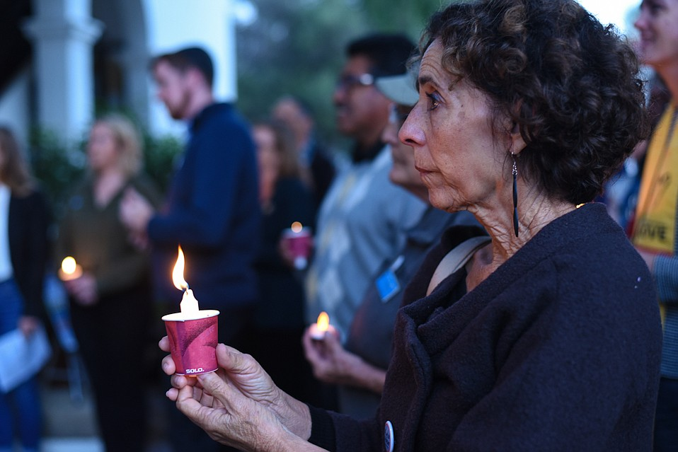 Community members gathered in mourning and solidarity with the victims of the Pittsburgh synagogue shooting.