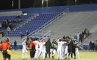 Cal State Fullerton celebrates after Samuel Goni converts his penalty kick to clinch the victory.