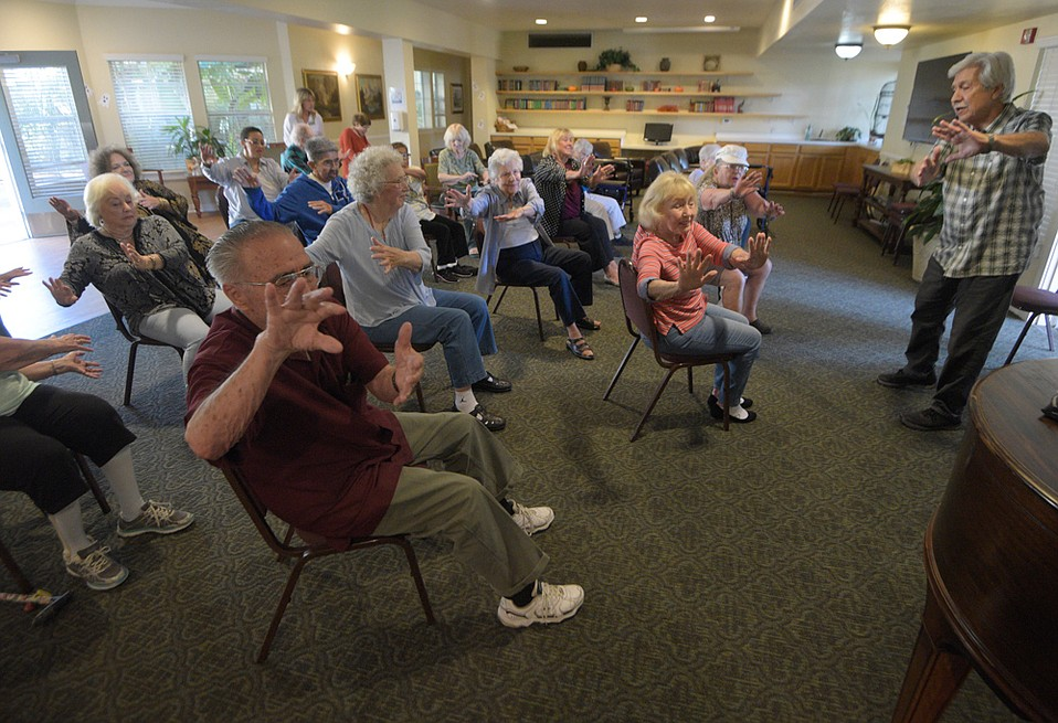 """Luis Sanchez teaches tai chi to a class at Garden Court as part of SBCC's Vitality Program. """"What matters is to get them to flow in motion, and that activates all the joints in the body,"""" he explained."""