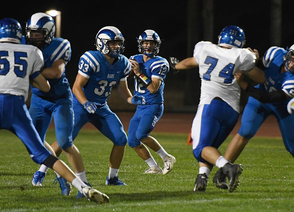 Quarterback Jack Deardorff (12) and coach Ben Soto led the Cate Rams to nine consecutive wins before they were upset in the CIF 8-man football quarterfinals.