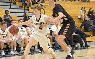 Dos Pueblos senior Jaron Rillie (4) hit six three-point baskets and scored 22 points in the Chargers' season opener, but they came up short against visiting Point Loma, 54-49.
