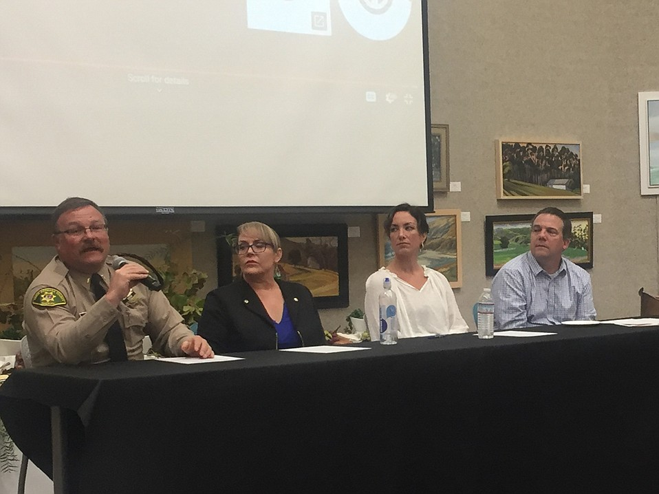 A county task force on human trafficking gathered at the Faulkner Gallery last week. pictured from left: Lt. Brian Olmstead (Sheriff's Office); Lisa Conn (RISE); Rita McGaw (office of the District Attorney); and event moderator Jeff Shaffer (Home for Good).