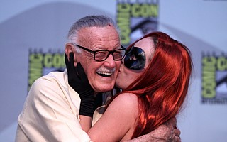 Stan Lee hugs a fan at a recent cosplay convention.