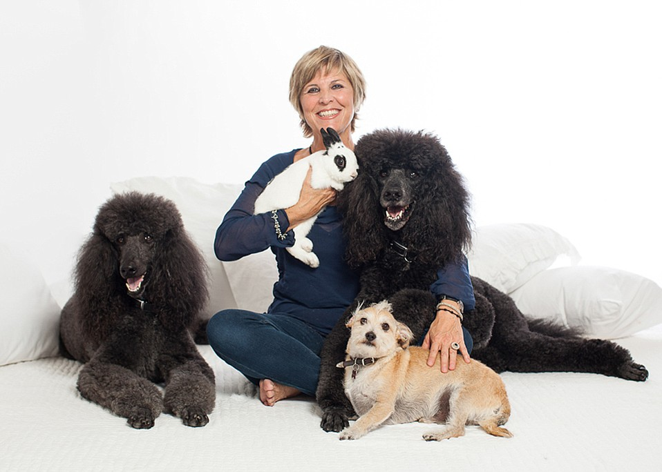Author Margarita Fairbanks with Valentino the bunny and her other four-legged friends.