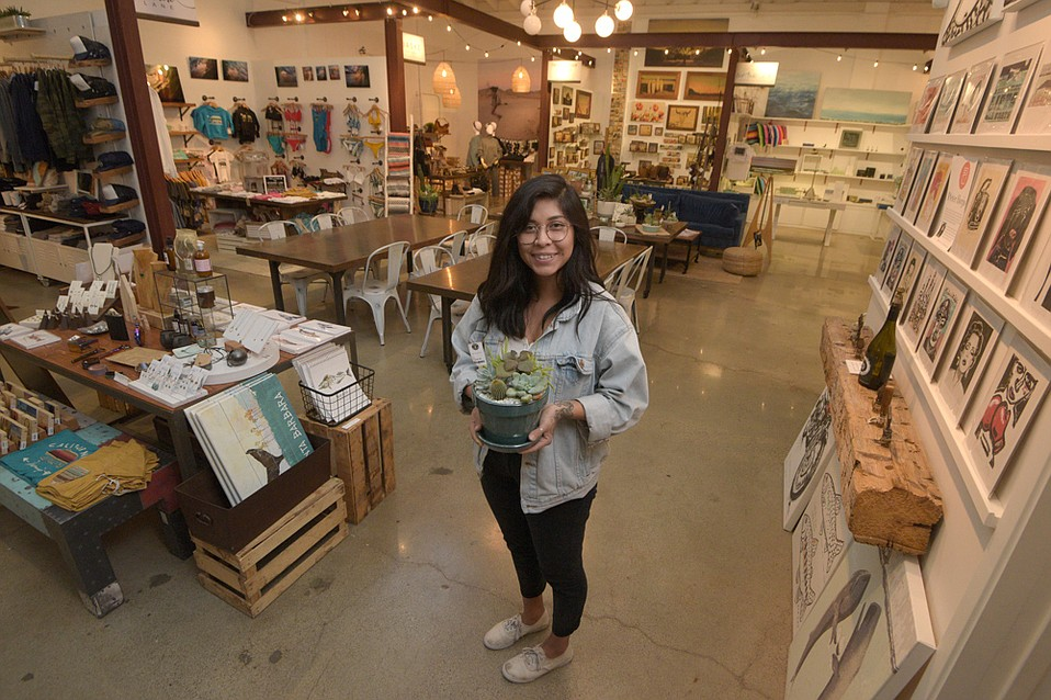 Waterline Assistant Manager Summer Alvarado with a succulent arrangement at Shops@Waterline, in the Funk Zone