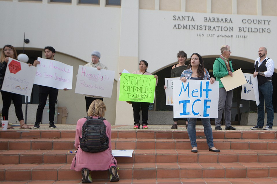 Demonstrators gathered Tuesday outside the county administration building.
