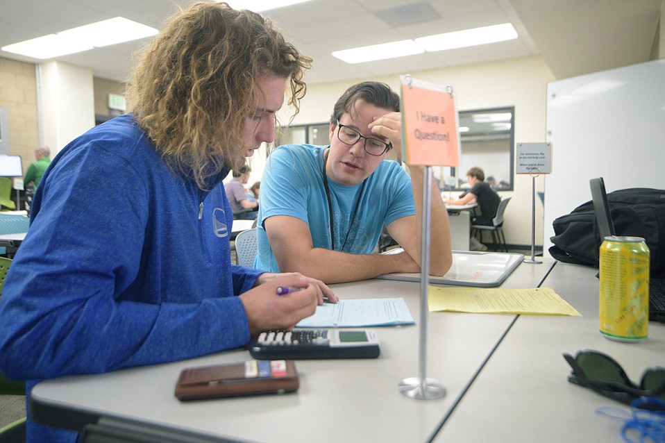 SBCC student Chad Mills (left) gets some assistance from Math Lab tutor Theo Bullock.