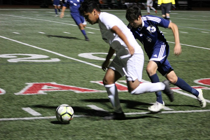 Juan Carlos Torres gets by Dos Pueblos defender Robert Montalvo