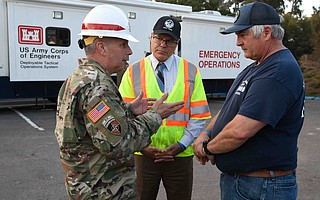 Public Works Deputy Director Tom Fayram (right) speaks with Lieutenant General Todd T. Semonite (left), Commanding General and Chief Army Corps of Engineers, soon after the debris flow.