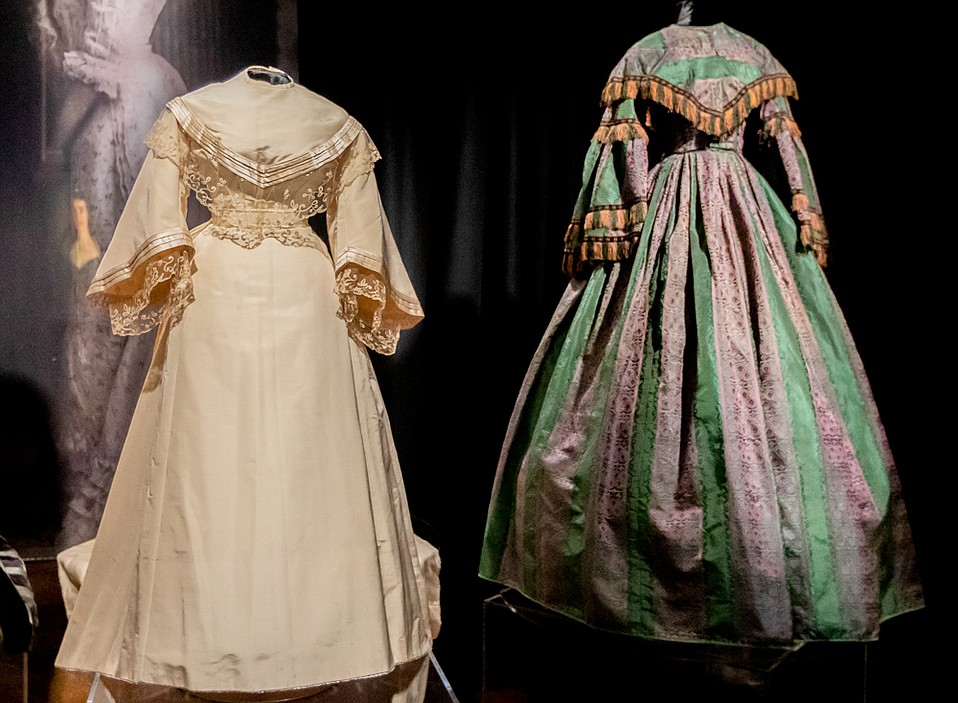 From Left: De la Guerra silk wedding dress (1836) and Trousseau green taffeta and cotton gown (1857)