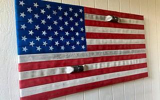 Retired firefighter John Carrillo created flag from old hose material.