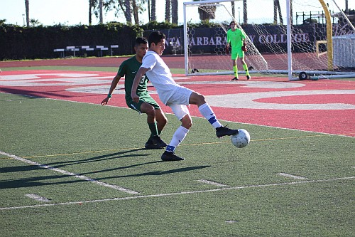 Miguel Mondragon protects the ball from Santa Barbara defender Alberto Vargas