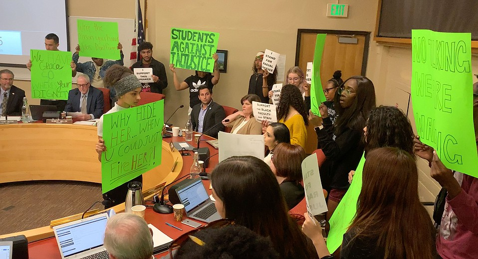 Students held a silent protest at Thursday's Santa Barbara City College Board of Trustees meeting in response to Vice President of Business Services Lyndsay Maas returning to campus after using a racial slur.