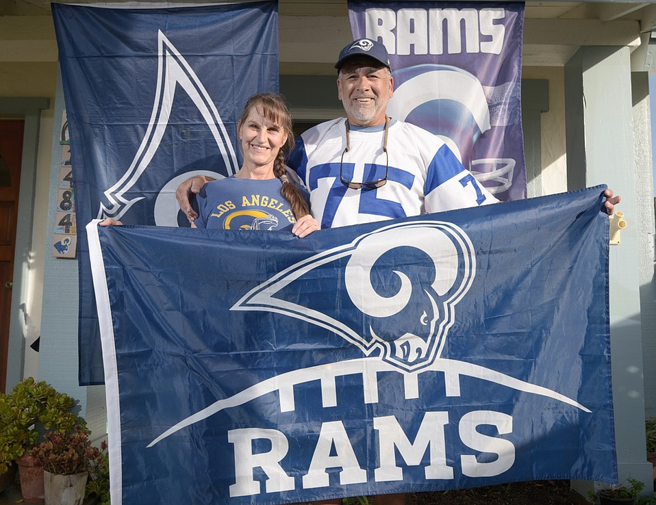 There will not be any neutrality when Nancy and Kiki Garibay host a Super Bowl party at their home in Carpinteria. Kiki is wearing a Deacon Jones jersey from the 1960s, when he started following the Rams.