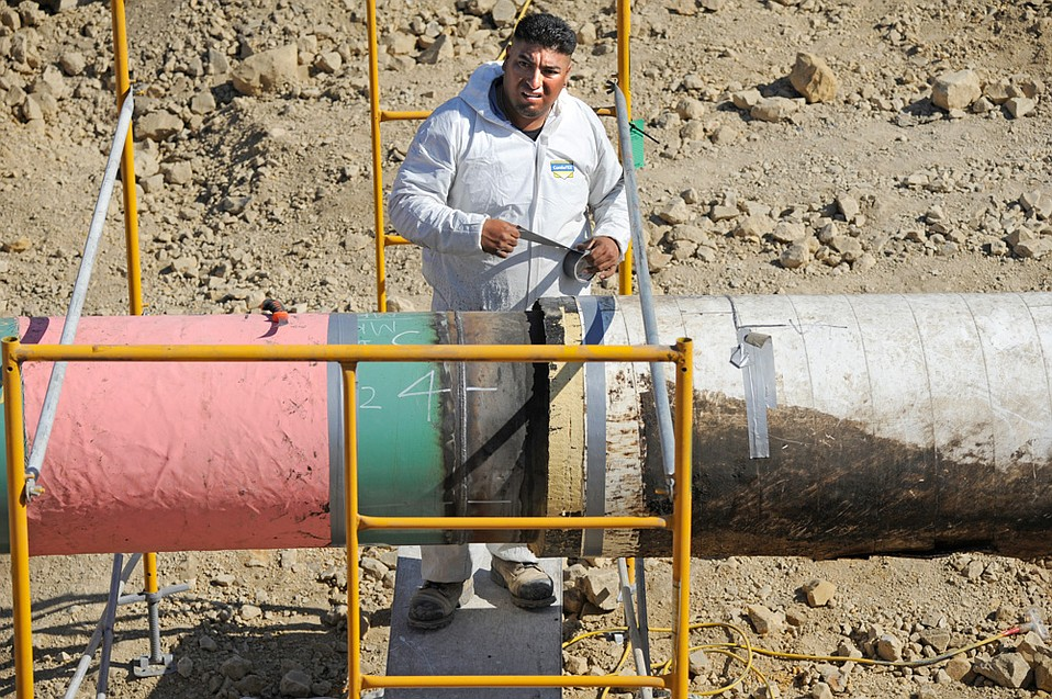 A crew member repairs the Plains pipeline section that leaked crude on Refugio Beach in 2015.