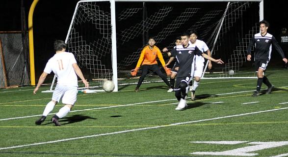 Carpinteria goalkeeper Adrian Gonzalez and  a host of defenders thwart a shot attempt by Santa Ynez forward Sam Villa