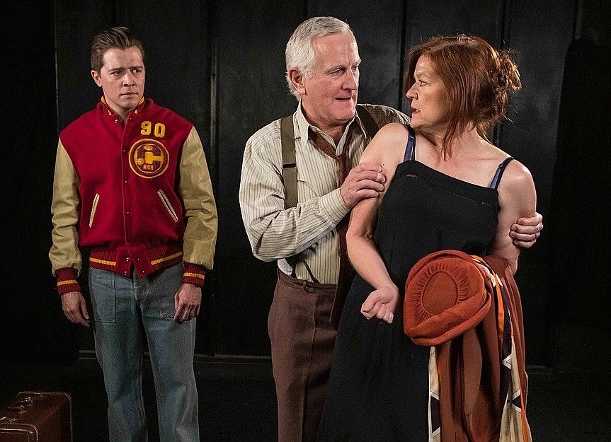 Trevor Peterson as Biff Loman eyes his father and mother as played by Henry Woronicz and Gigi Bermingham in Ensemble Theatre Company's revival of Death of a Salesman.