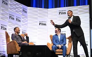 Michael B. Jordan, moderator Scott Feinberg and Jamie Foxx speak onstage at the SBIFF