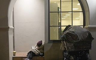 A homeless woman sleeping on State Street on a cold January night.