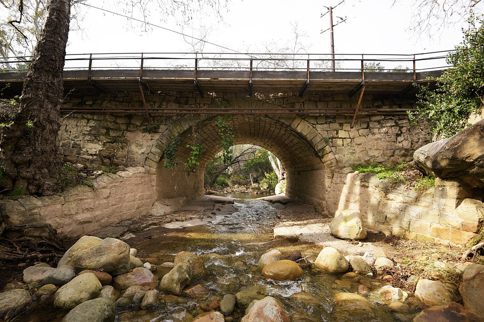 Where Mission Canyon Road crosses over Mission Creek, the historic bridge — an earth-filled, closed spandrel masonry arch, composed of smooth-cut, square stones, that withstood the 1925 earthquake — is being scrutinized by engineers and historians for its obsolete or unique characteristics, depending on who is asked.