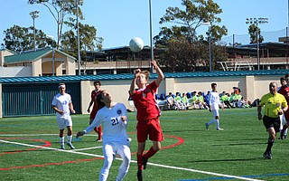 Harry Powers goes up for a header.