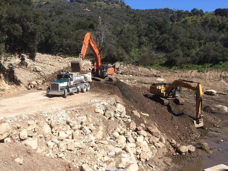 Winter rains are keeping County Flood Control busy clearing front country debris basins, as hillsides have little vegetation after 2017's Thomas Fire and continue to produce rock and mud; the material is being taken to beaches in Goleta and Carpinteria.
