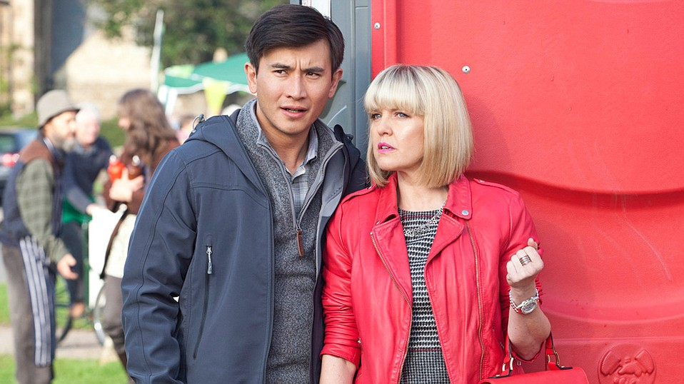 Bill Wong (Matt McCooey) and Agatha Raisin (Ashley Jensen) spend their days solving murders with flair in the British mystery series Agatha Raisin.