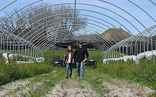 Sara Rotman and her husband, Nate Ryan, on their farm