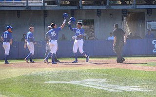 Armani Smith celebrates his two-run homer in the bottom of the fifth inning.