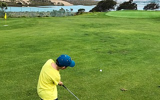 The author's son, Mason, tees off at Sea Pines Golf Course in the morning and jumps in Montaña de Oro tide pools in the afternoon.